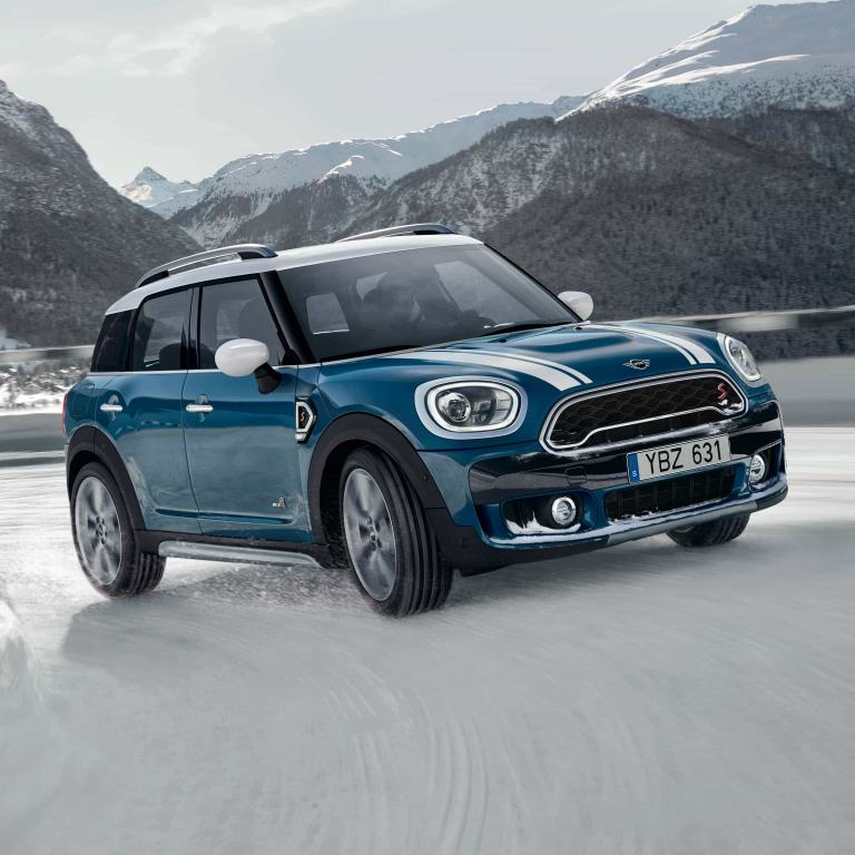 MINI Countryman drives up a mountain road with All4 All-Wheel Drive