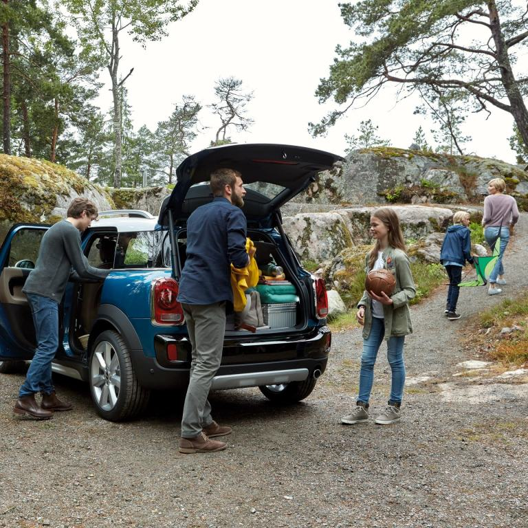 MINI Countryman boot space is getting unpacked by a Family of five